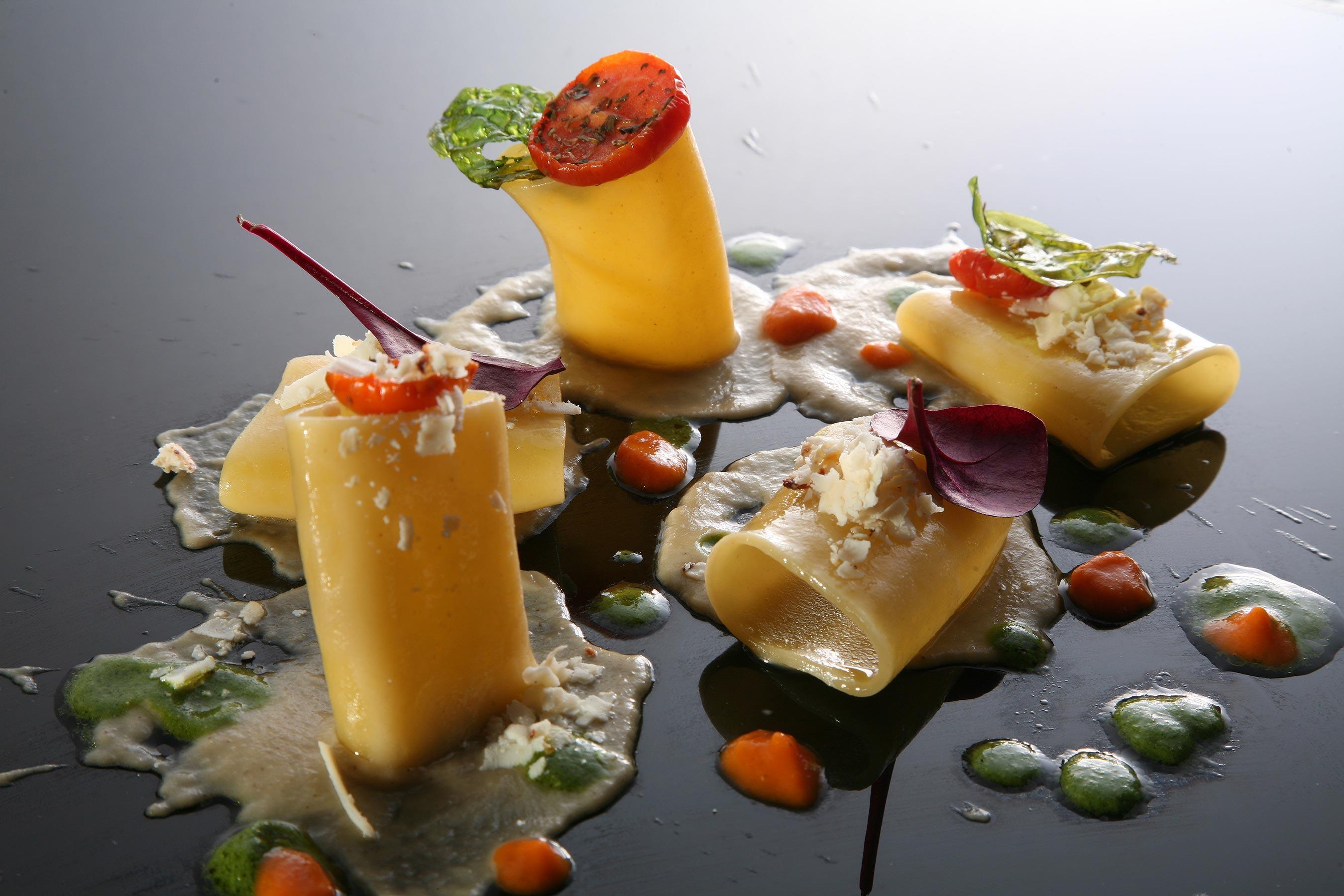 Tortelli alla clorofilla di basilico ripieni di baccala mantecato ricotta di pecora e mandorle tostate